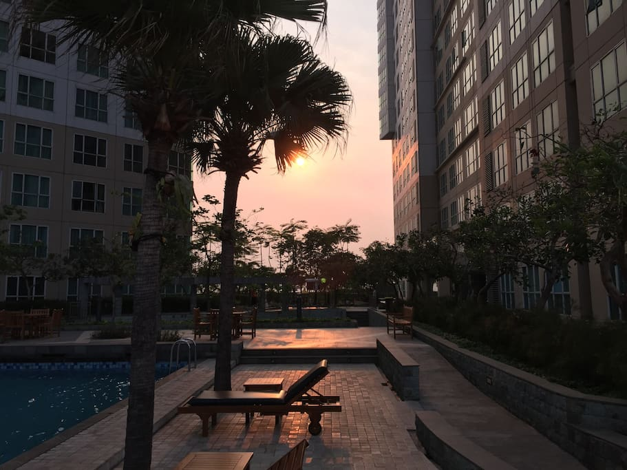 The view on the 5th floor Pool area where you can jog, play tennis and kids have their own playground such as swing