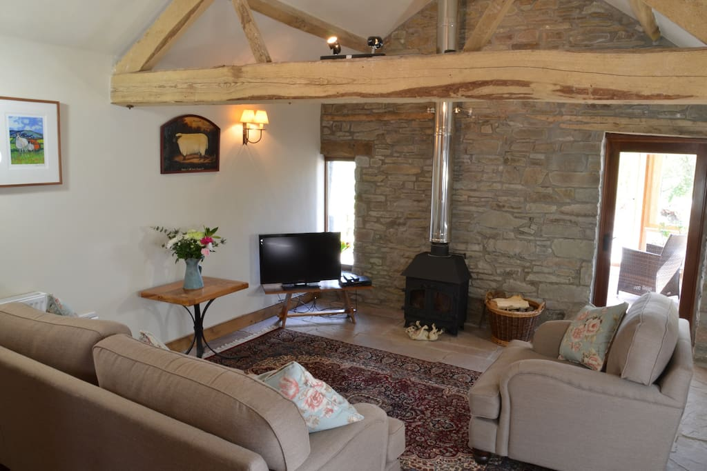 The log burning stove- and free wood- provide a cosy backdrop. Winter time is a popular time to visit us. We have a very good DVD library and there are also board games and magazines.