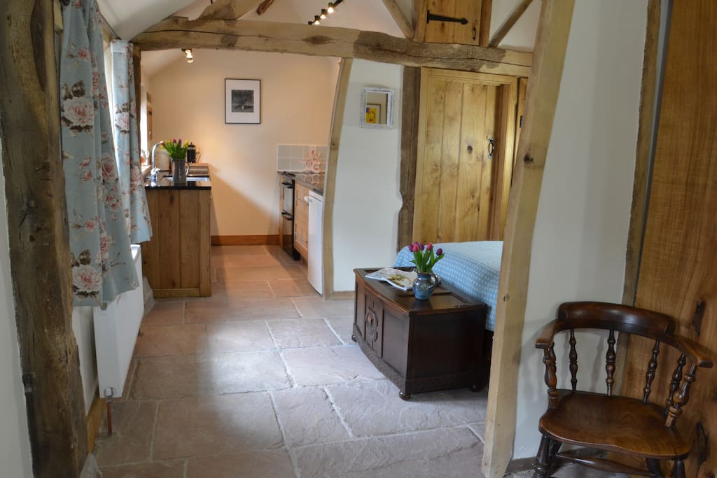 We've been described as supremely relaxing- try out the Welsh Walnut bed, handmade of course, with gorgeous bed linen and fabulous Welsh blankets. The Byre is deceptive. There's lots of space and the kitchen, although small, is well equipped.