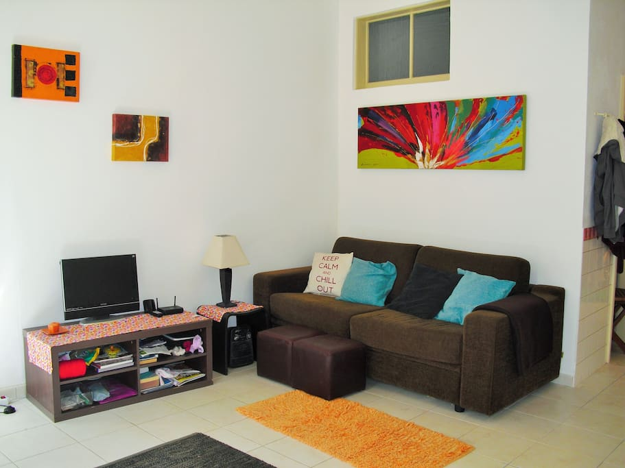 Main living room, open plan with lots of natural light. and double sofa bed.