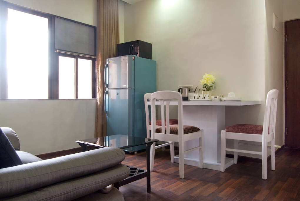 Dining area with refrigerator, microwave & electric kettle