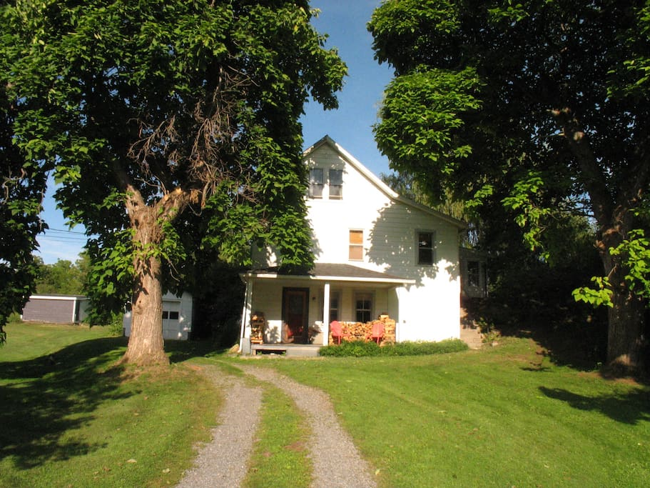 front view of our house with two large old catalpa trees