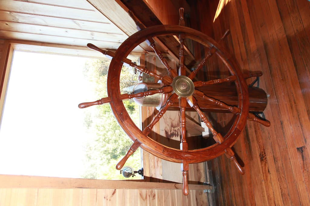 The captains wheel in the master bedroom.