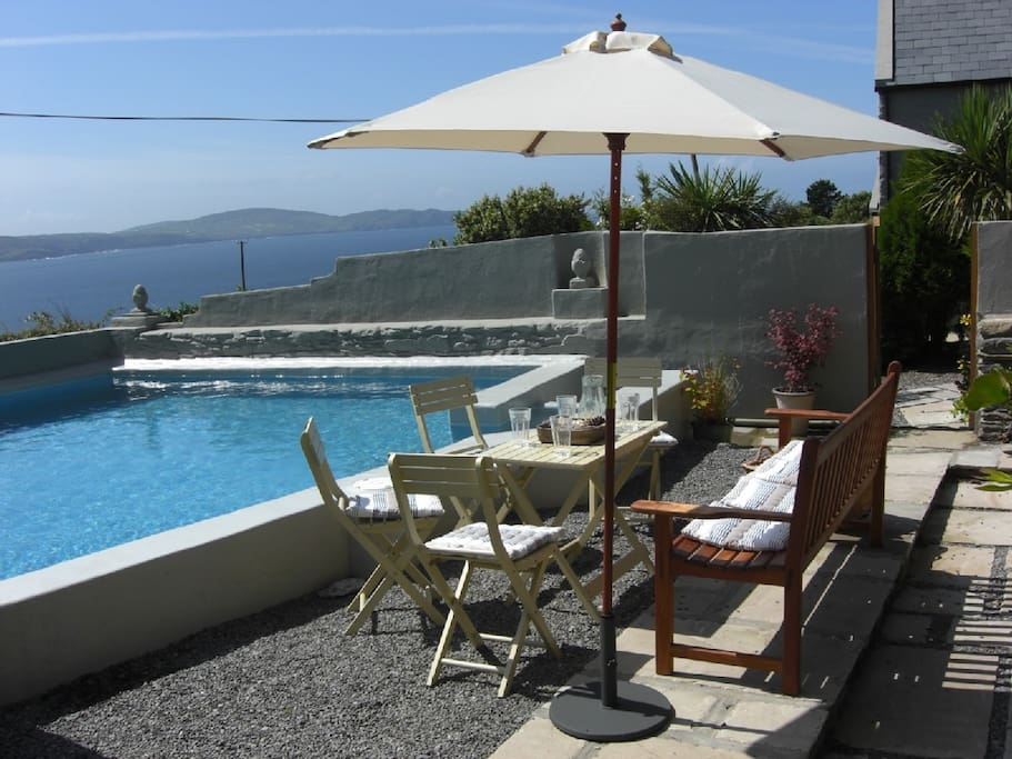 Laharandota - the outdoor pool with patio area overlooking Dunmanus Bay