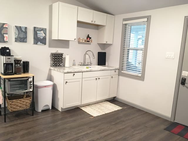 Bright, large kitchenette with all your cooking basics - hotplate, toaster oven, microwave, fridge, and coffee maker.