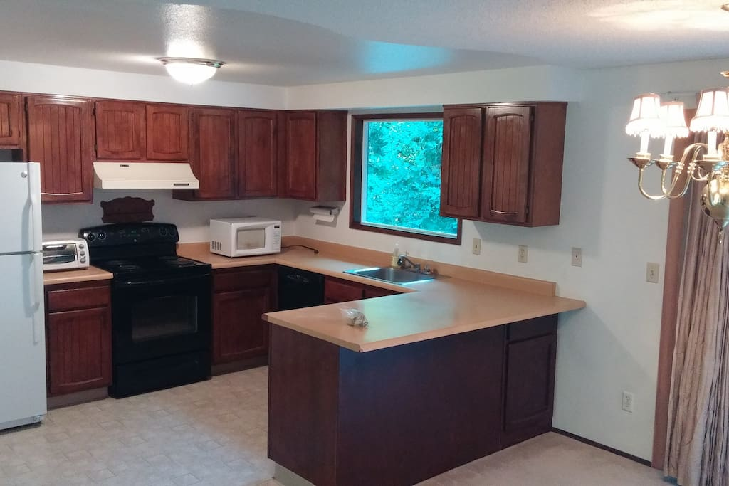 The kitchen is large and functional.