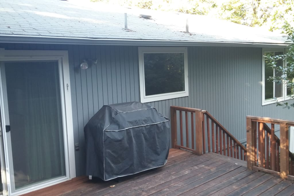 There is a barbecue on the back deck.
