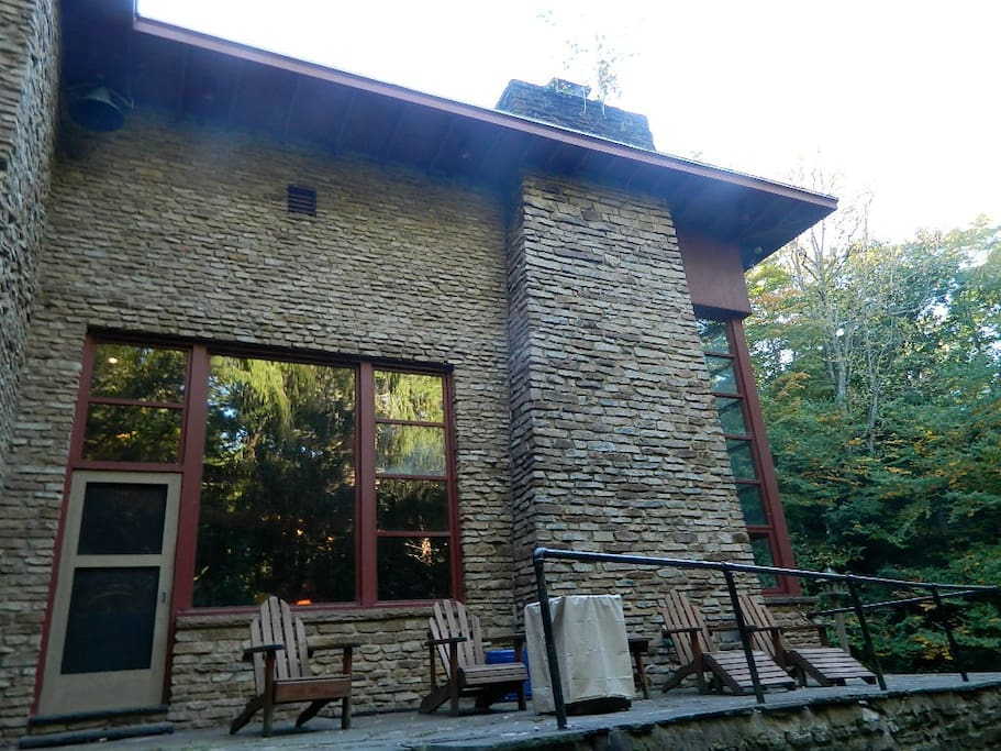 Elevated back patio of the MVL.  Several adirondack chairs & outdoor gas fireplace make entertaining and chilling out equally attainable with ease