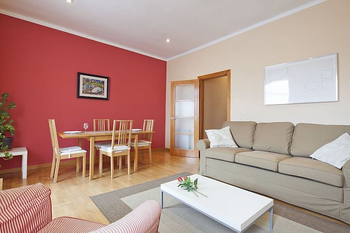 Living & dinning room with a large queen double sofa bed.