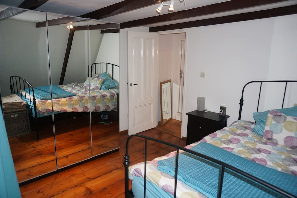 "Room #1's bedroom: the room you get when booking under this listing ""Room #1"""