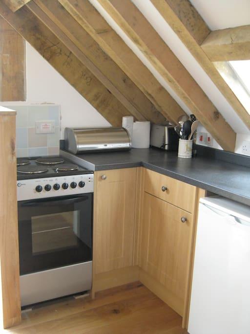 kitchen area within open plan studio
