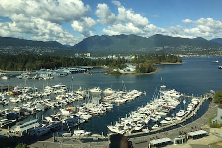 Newly furnished condo with balcony & ocean view right at downtown beach, Coal Harbour. In-suite laundry, pool, hot tub, gym. Walk to Convention Center, Canada Place, Stanley Park, Robson street, restaurants, bars, Cafe, liquor store, grocery stores.