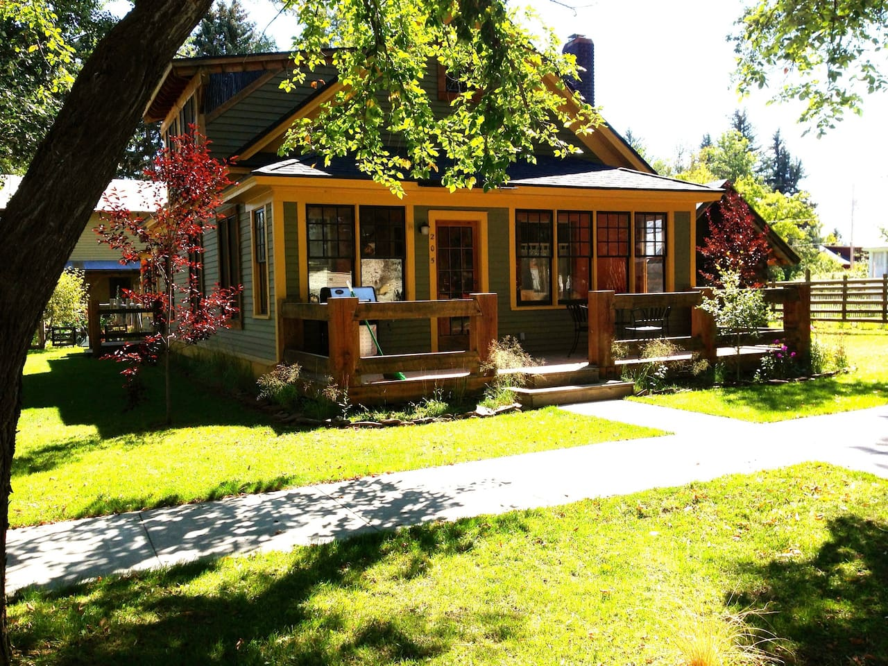 Guesthouse and front deck in summer
