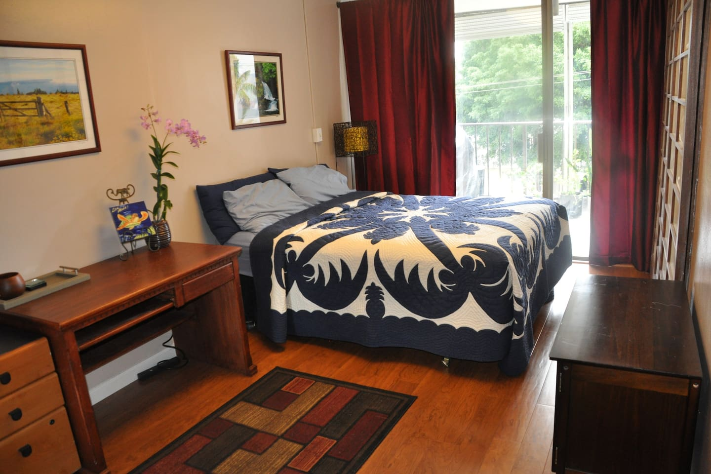 Guest Room with queen size bed.  Sliding door Access to lanai.