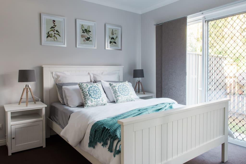 Main bedroom has queen sized bed & built in robe