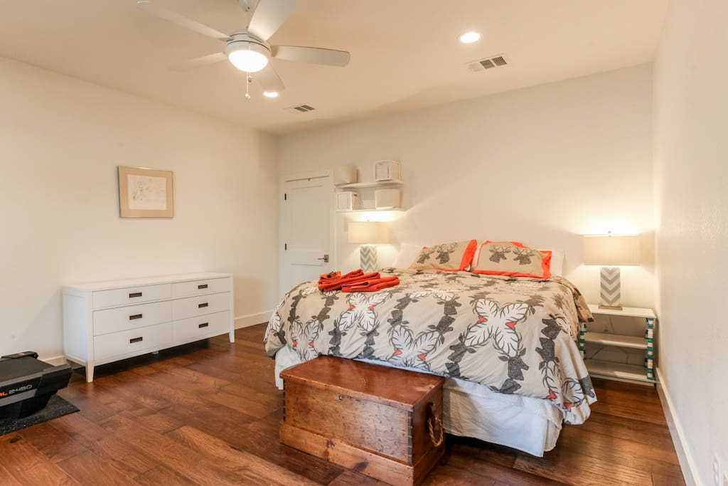 The master suite with king-sized bed is expansive and light filled
