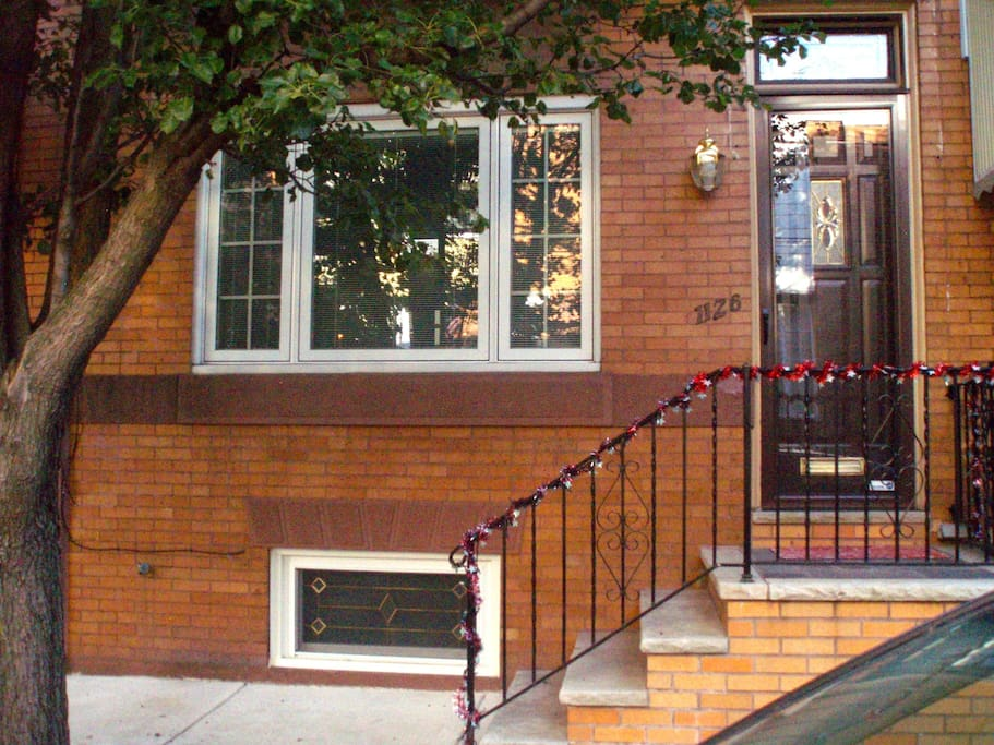 Brick row house on a  quiet tree-lined block.