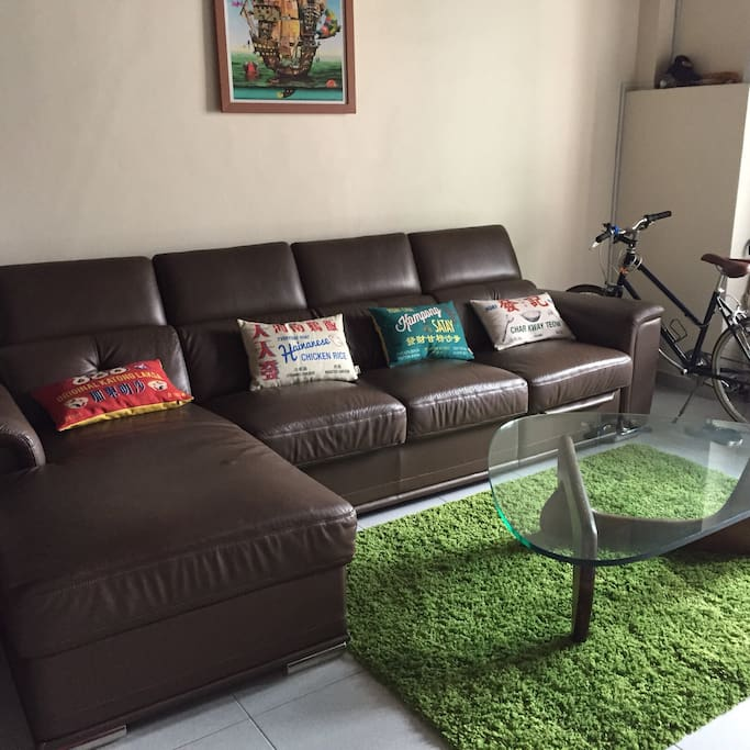 Comfortable leather sofa with recliner to watch TV on 55 inch flatscreen