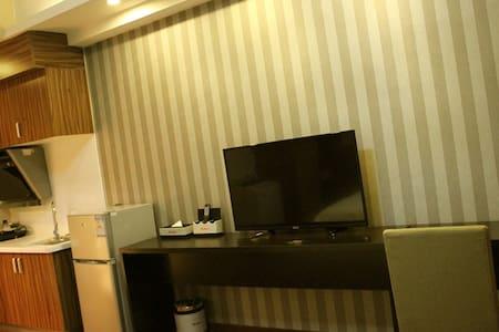 拜登盛邸服务公寓(晋江万达)高级双床房 - Quanzhou - Apartment