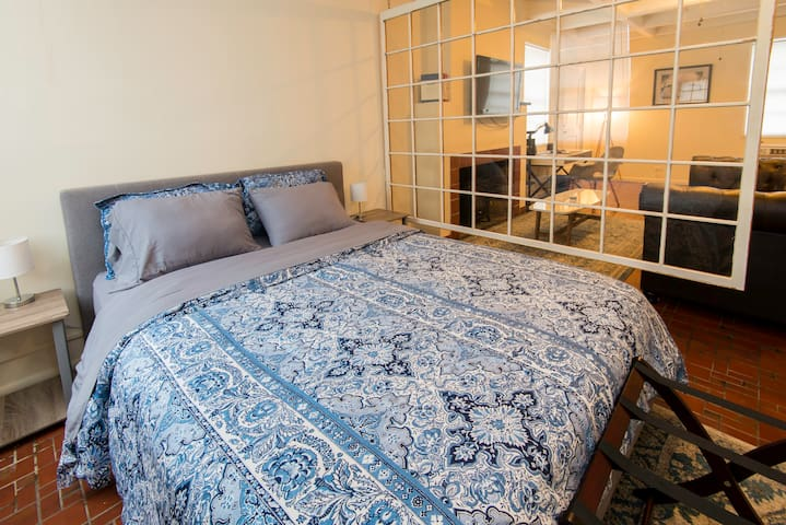 Relax on a comfortable queen size bed at the end of a long day.