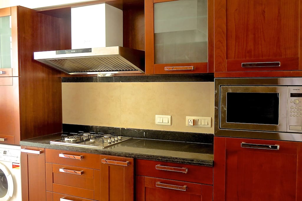 fully fitted out kitchen; toaster; hobs; microwave; dishwasher; washing machine; air-conditioned