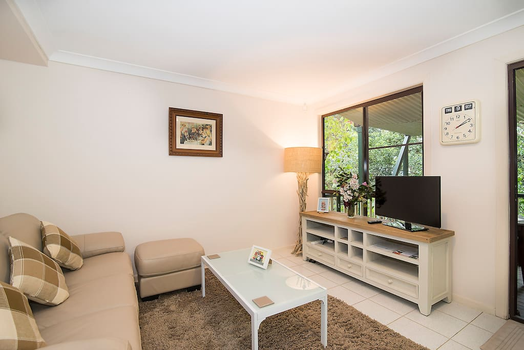 Comfy living space, featuring soft real leather sofa and LED HD TV.