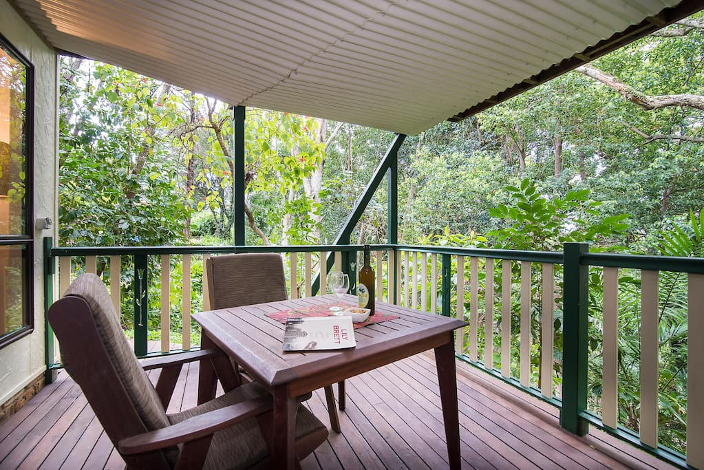 Sit amongst the trees on your private deck and enjoy a hard-earned evening drink.