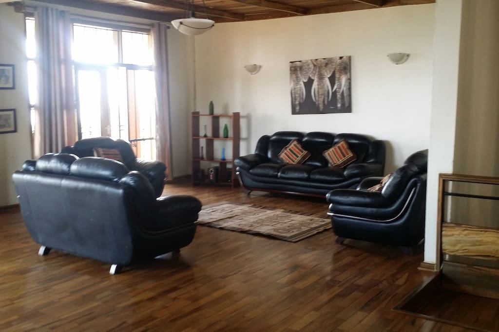 African themed Sitting room with wooden floor African themed decor
