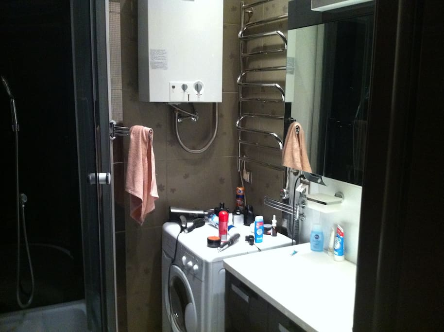 Bathroom with shower cabin and washing machine