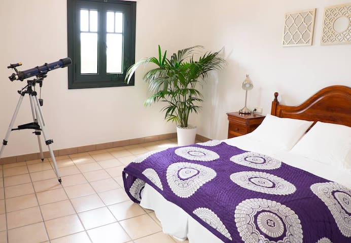 Master Bedroom, with french doors to patio and views to Fuerteventura