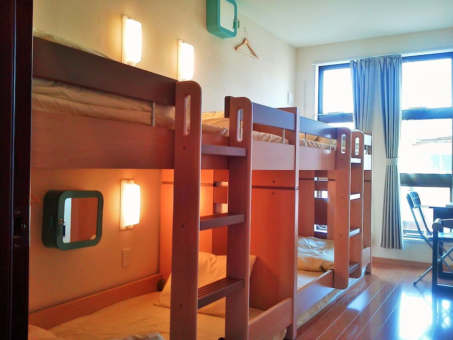 2 bunkbeds and a desk