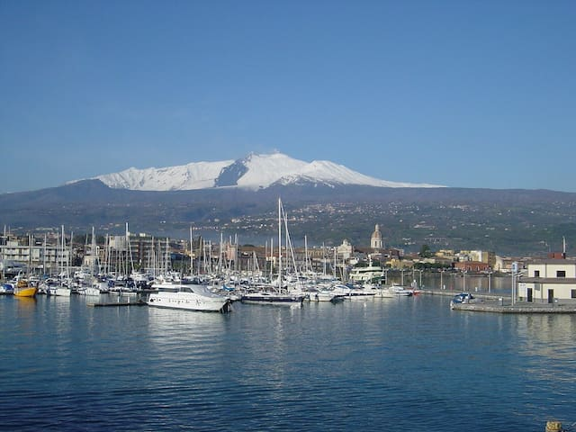Dipped in the Blue Sea and see Etna