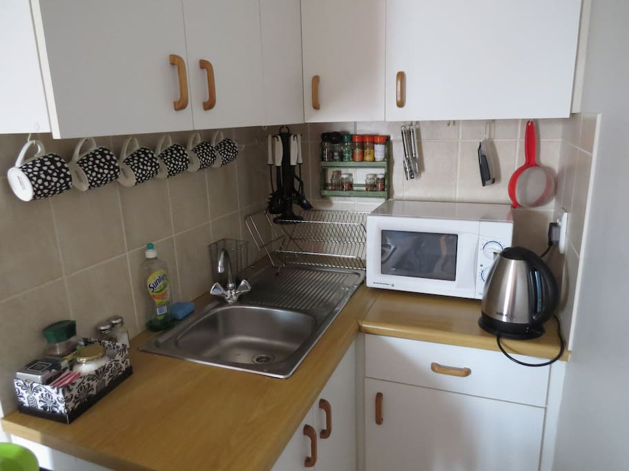 Kitchenette for light meals and wash-up. Coffee, tea, sugar, milk plus crockery and cutlery.