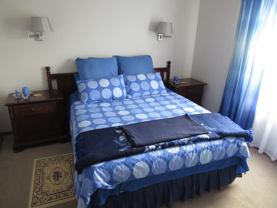 Queens size bed with side tables.