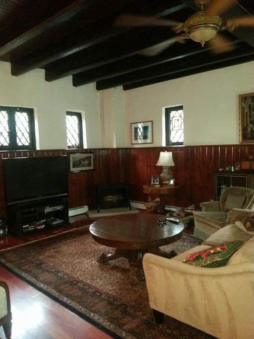 2nd living room, cozy, wood beam ceiling, fireplace, large screen TV