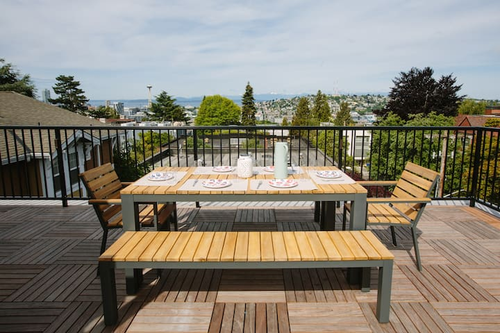 Above your unit, you'll have exclusive access to a 450 square foot private deck with grill and panoramic views of the city - from downtown, past the Space Needle over Lake Union to Queen Anne.