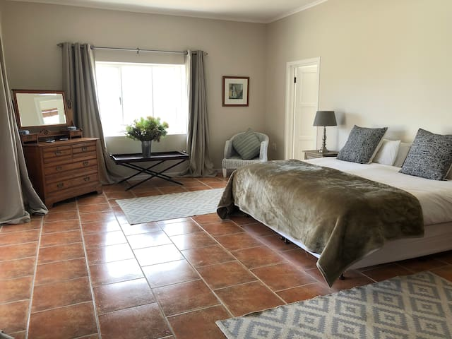 The main bedroom has a very comfortable king-size bed with electric blanket and thick furry blanket for cold nights. There is an oak wardrobe and chest of drawers so you can unpack and hang your clothes.
