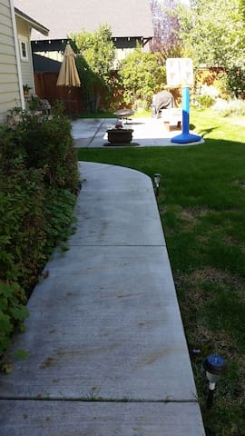 Well lit, cement walkway nicely groomed