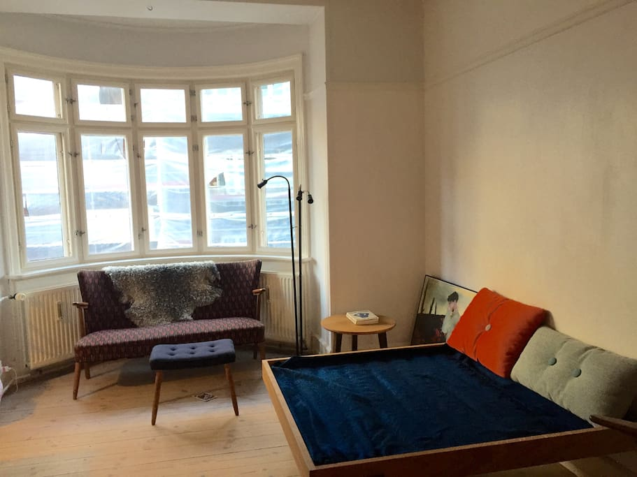 Living room on second floor with an extra day bed that can be used by a child as bed
