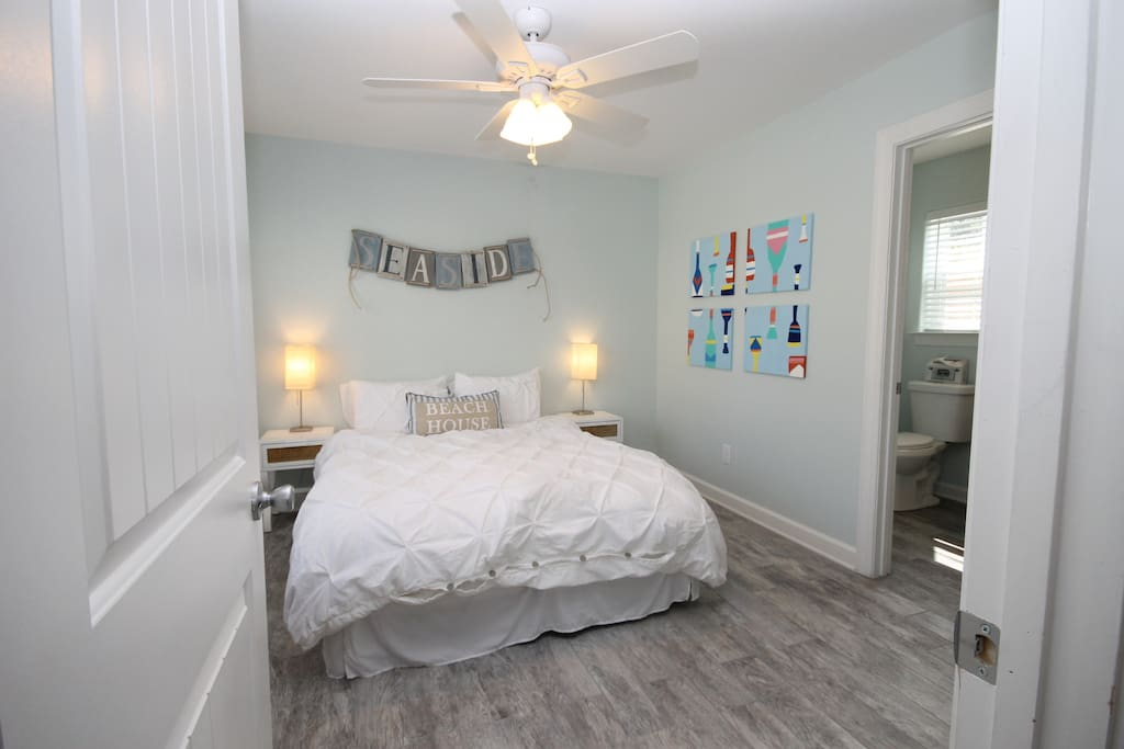 Large, sunlight filled guest suite with queen size bed and full bathroom.