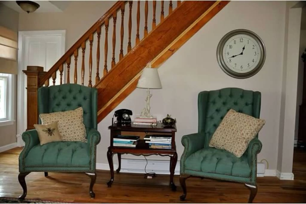 Living room features a quaint sitting room with chairs, a sofa, period antiques, a complimentary guest phone and Wi-Fi.