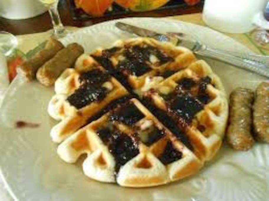 Full gourmet breakfast featuring a homemade Belgian waffle with homemade blackberry syrup by proprietor, Nathan, with berries picked by him and his son on the Island.