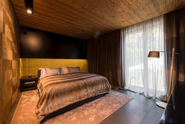 Bedroom with double bed TV and stunning view