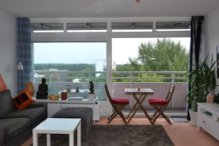"""The apartment is in the 7th floor with a view on the one side to the Hamburg harbour area (in between is the Botanic Garden) while you can see the shopping mall """"Elbe Einkaufscenter"""" on the other side. Public transport and parking is also easy"""