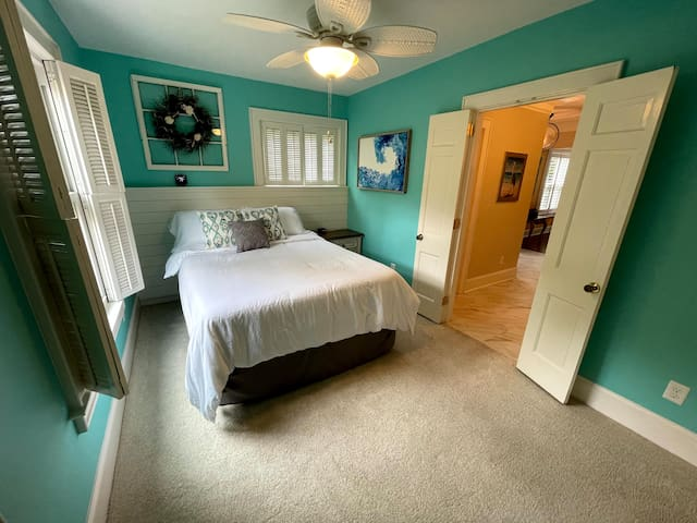 This bedroom is down stairs with attached bathroom. Large doors. Great shower!