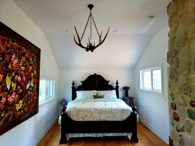 Bedroom B. 3rd floor attic. King bed. Water view.