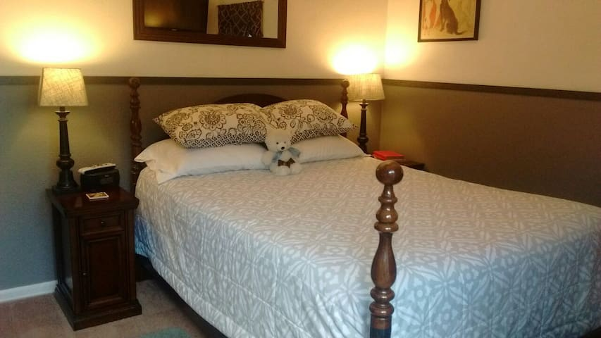 queen size bed with plush bedding