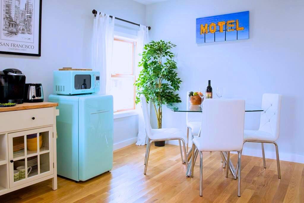 Kitchenette - microwave, mini fridge, kettle, Keurig coffee machine, and toaster.