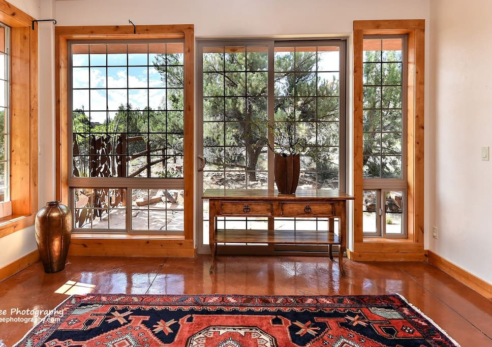 Floor to Ceiling windows greet you in foyer.