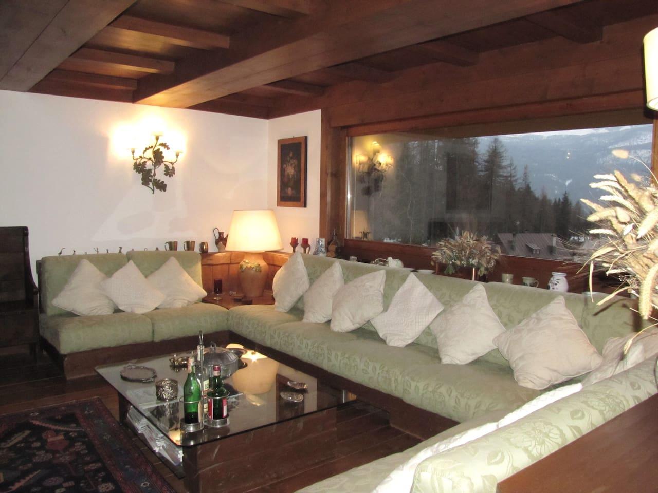 Elegant sitting area with panoramic windows facing Cortina